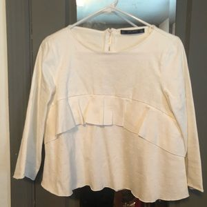 White blouse with zippered back detail